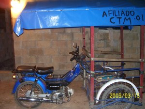 A tricitaxi is perfect for navigating a small town!  I wish I had one here!