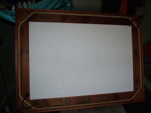 The bulletin board is large, but not heavy.